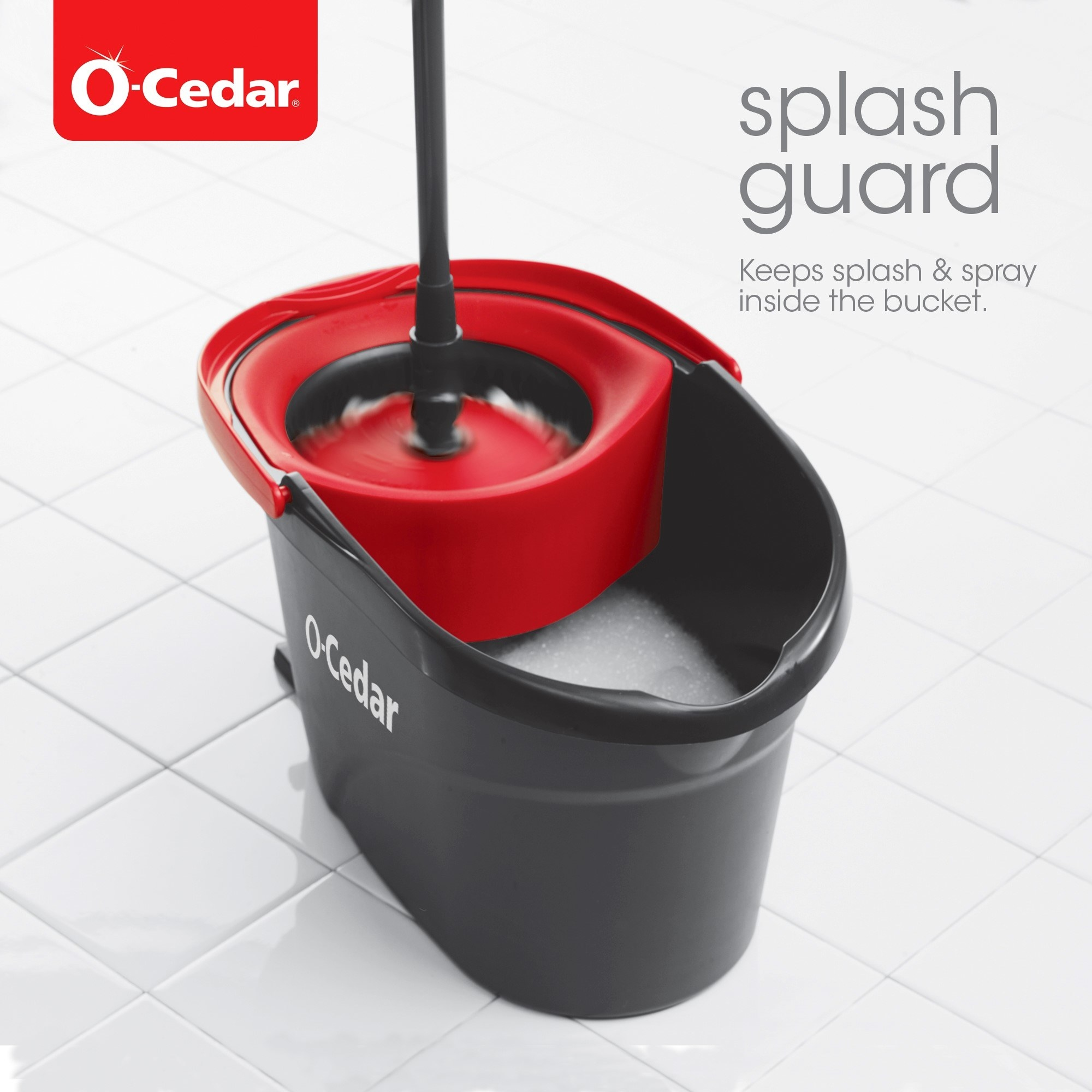Black bucket with O-Cedar logo in white and red foot pedal/detailing next to mop with black handle, red mop head with white brush
