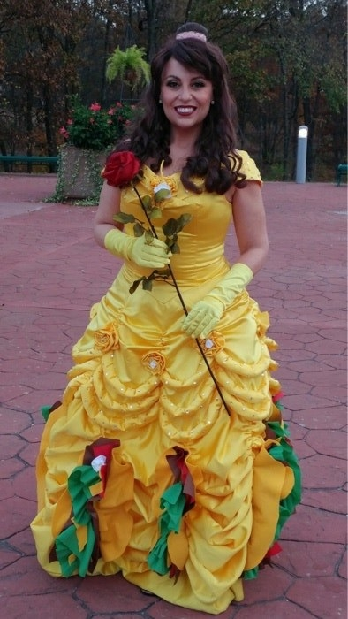 A woman dressed as Princess Belle with tacos at the bottom of her dress