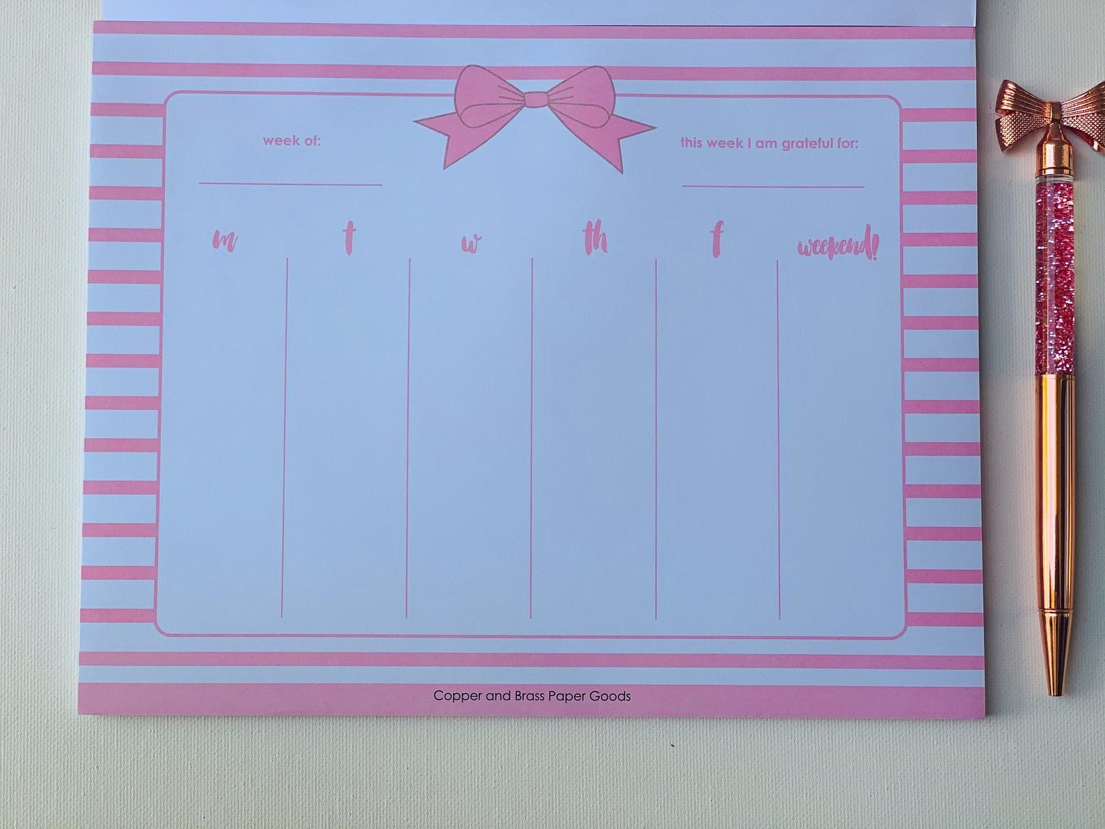 The rectangle notepad with a spot for each day of the week