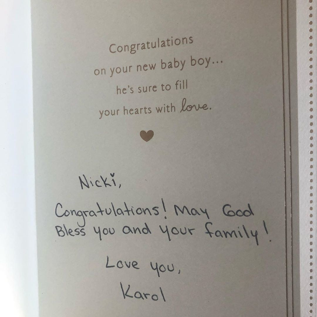 """A note from Karol G reading, """"Nicki, congratulations! May God bless you and your family. Love you"""""""