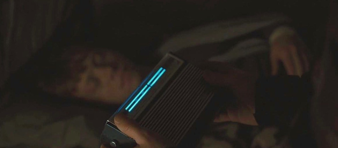 Harry holding a radio near Ron while Ron sleeps