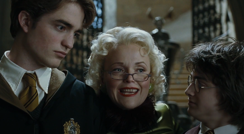 "Rita Skeeter standing in-between Cedric and Harry in ""Goblet of Fire"""
