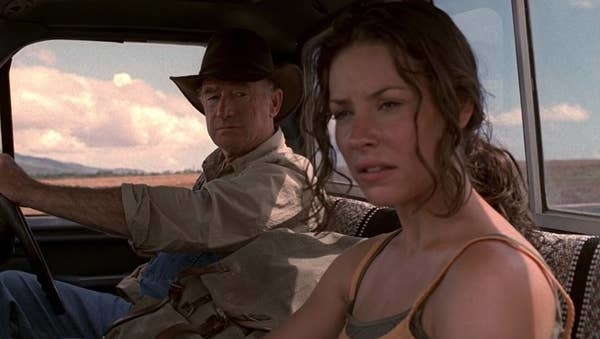 "An image from the TV show ""Lost"" showing two characters driving round the Australian Outback"