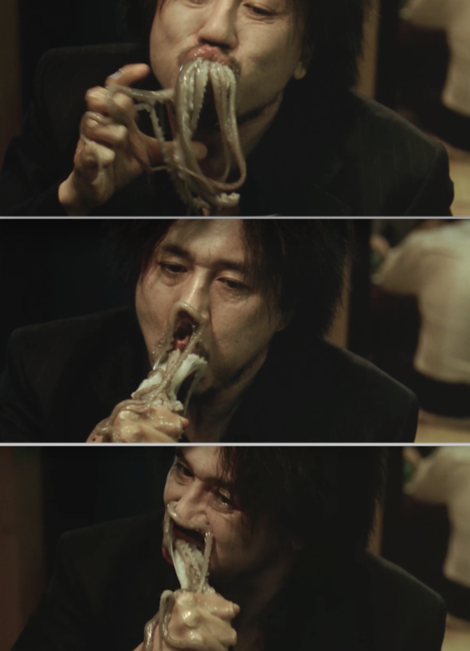 Dae-su eating a whole, live octopus in the restaurant
