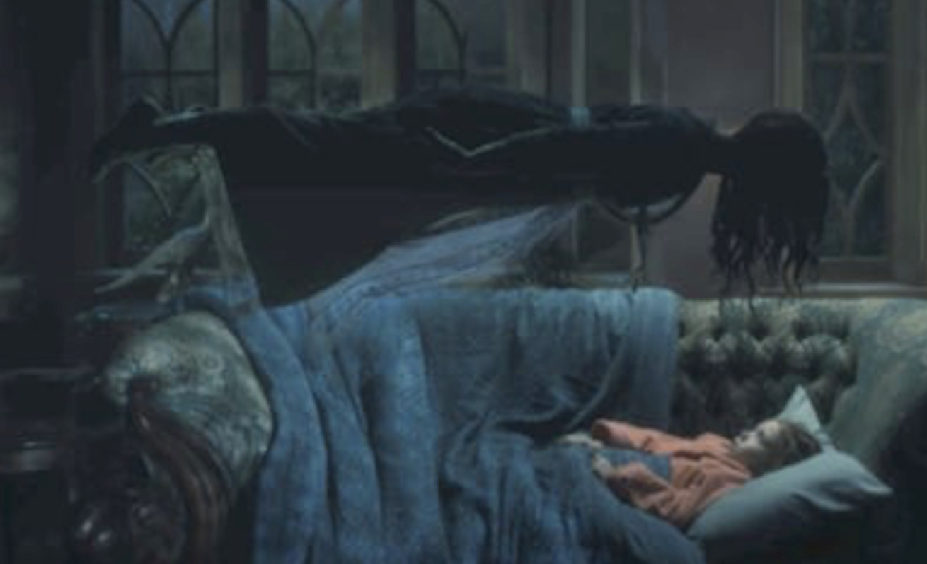 A ghostly woman is hovering and floating above a girl who is laying on the couch