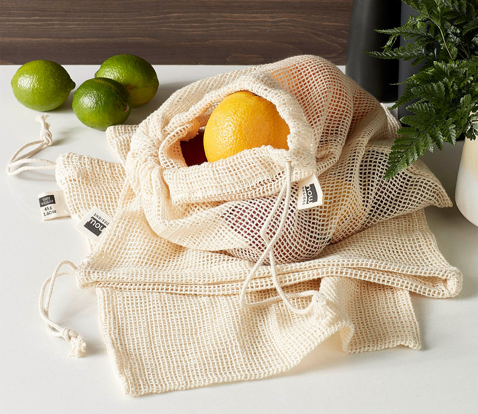 A small mesh bag filled with fruits