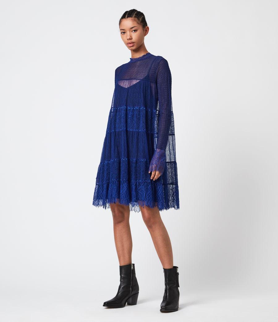 Model wearing the knee-length dress in blue