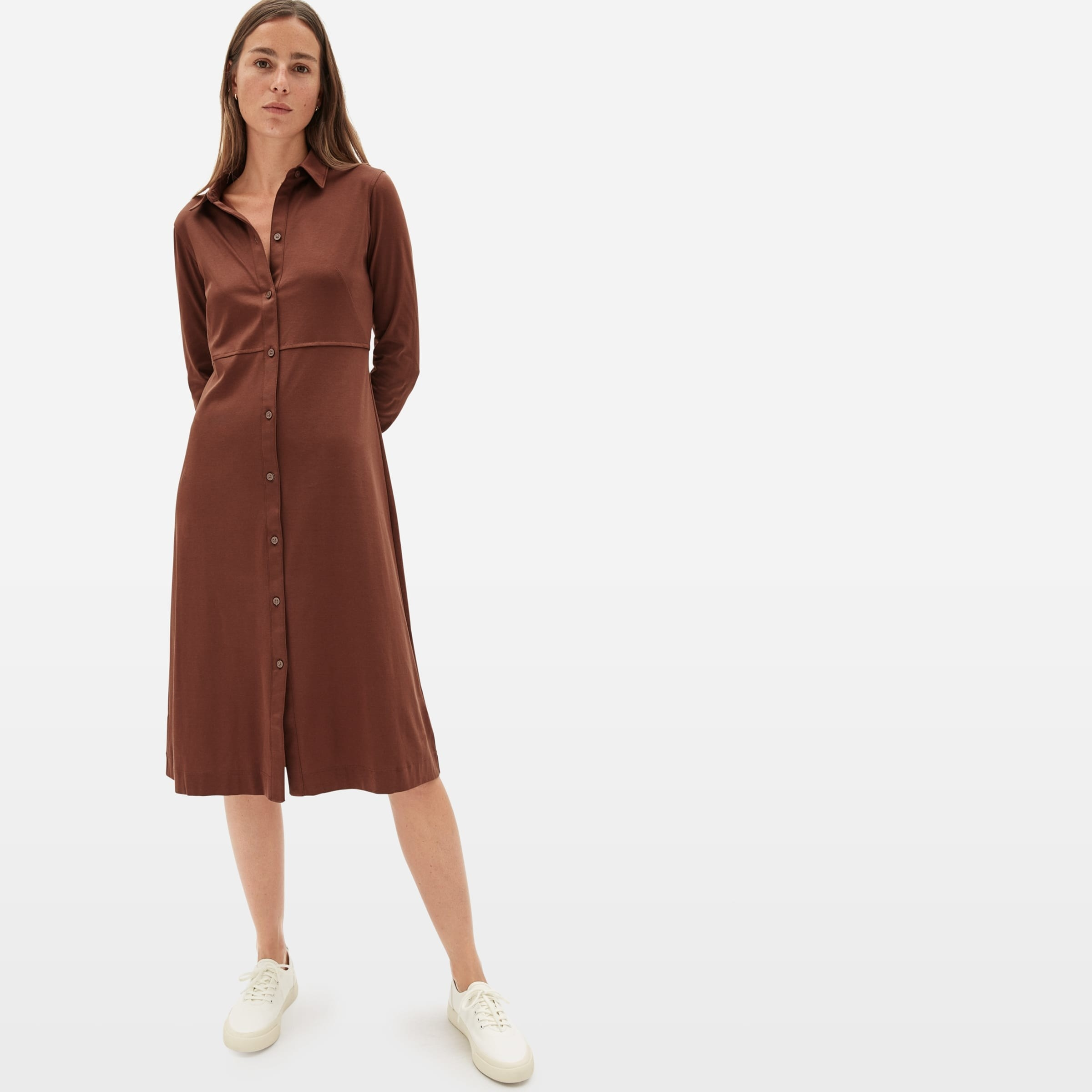 Reviewer wearing the collared brown dress, which has buttons down the center