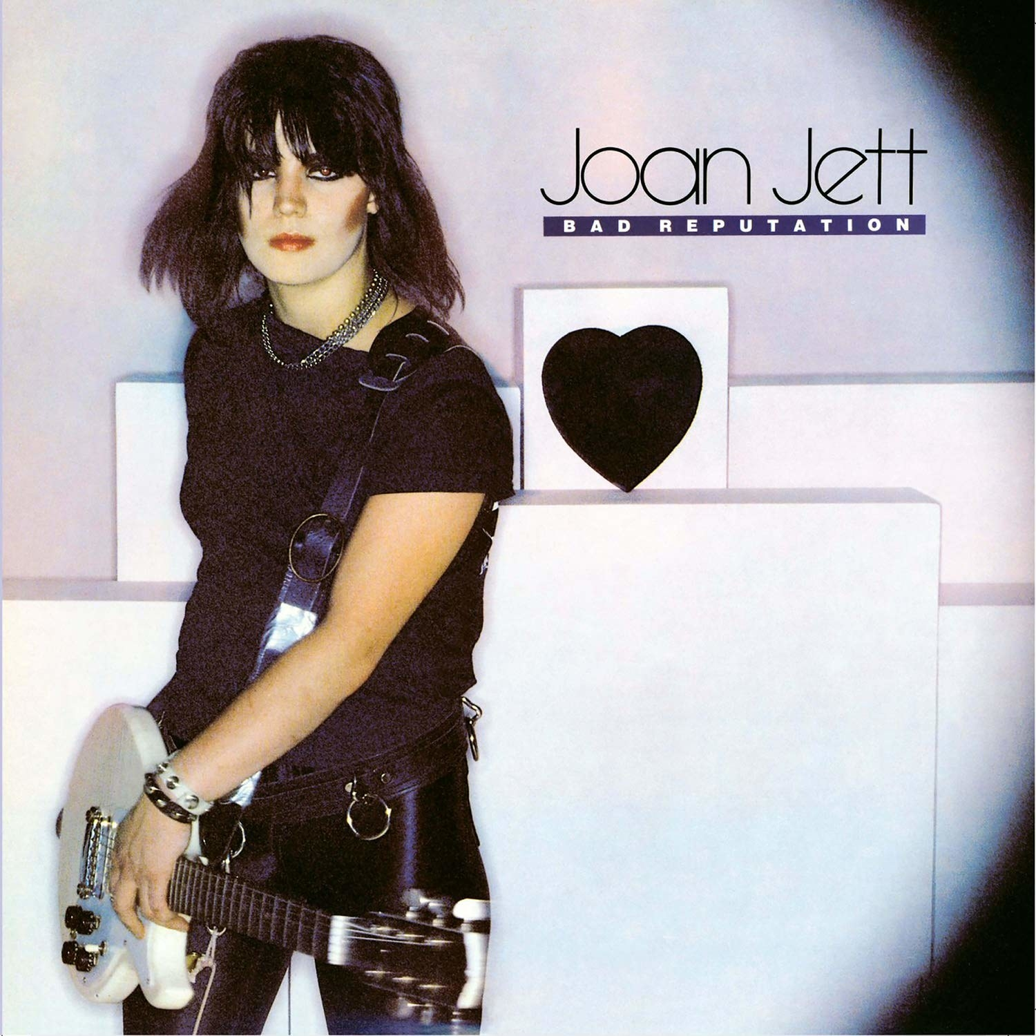 album cover of Bad Reputation showing Joan Jett standing with her guitar