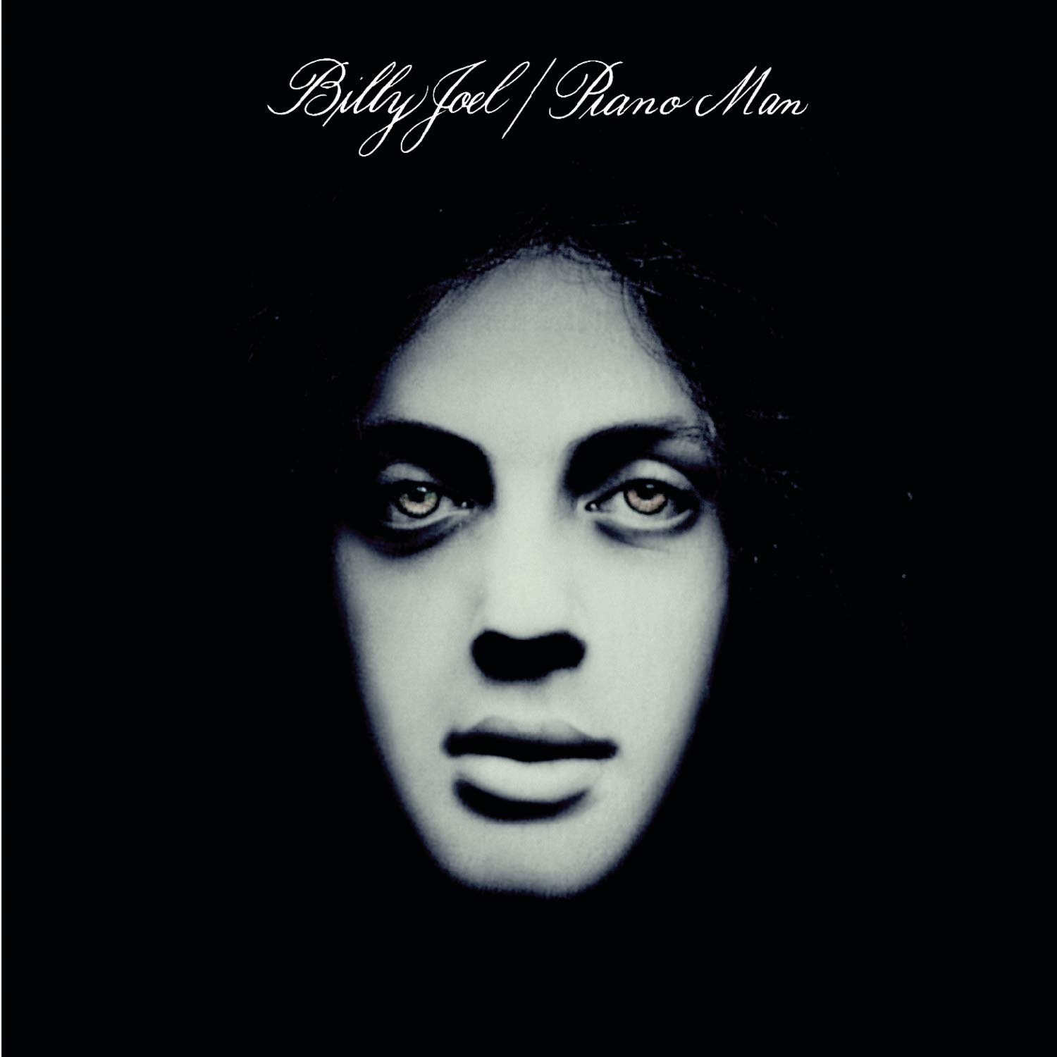 album cover of Piano Man showing Billy Joel's face coming out of darkness