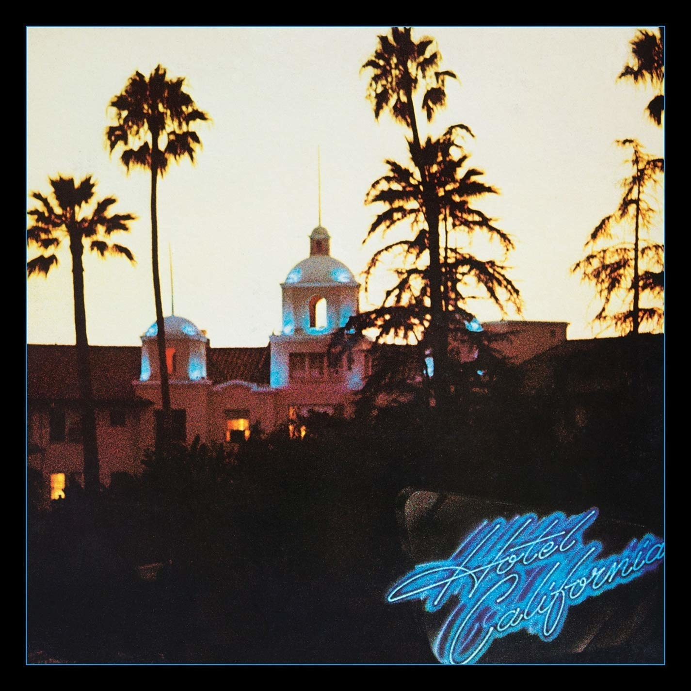album cover of Hotel California showing a hotel with palm trees in the distance