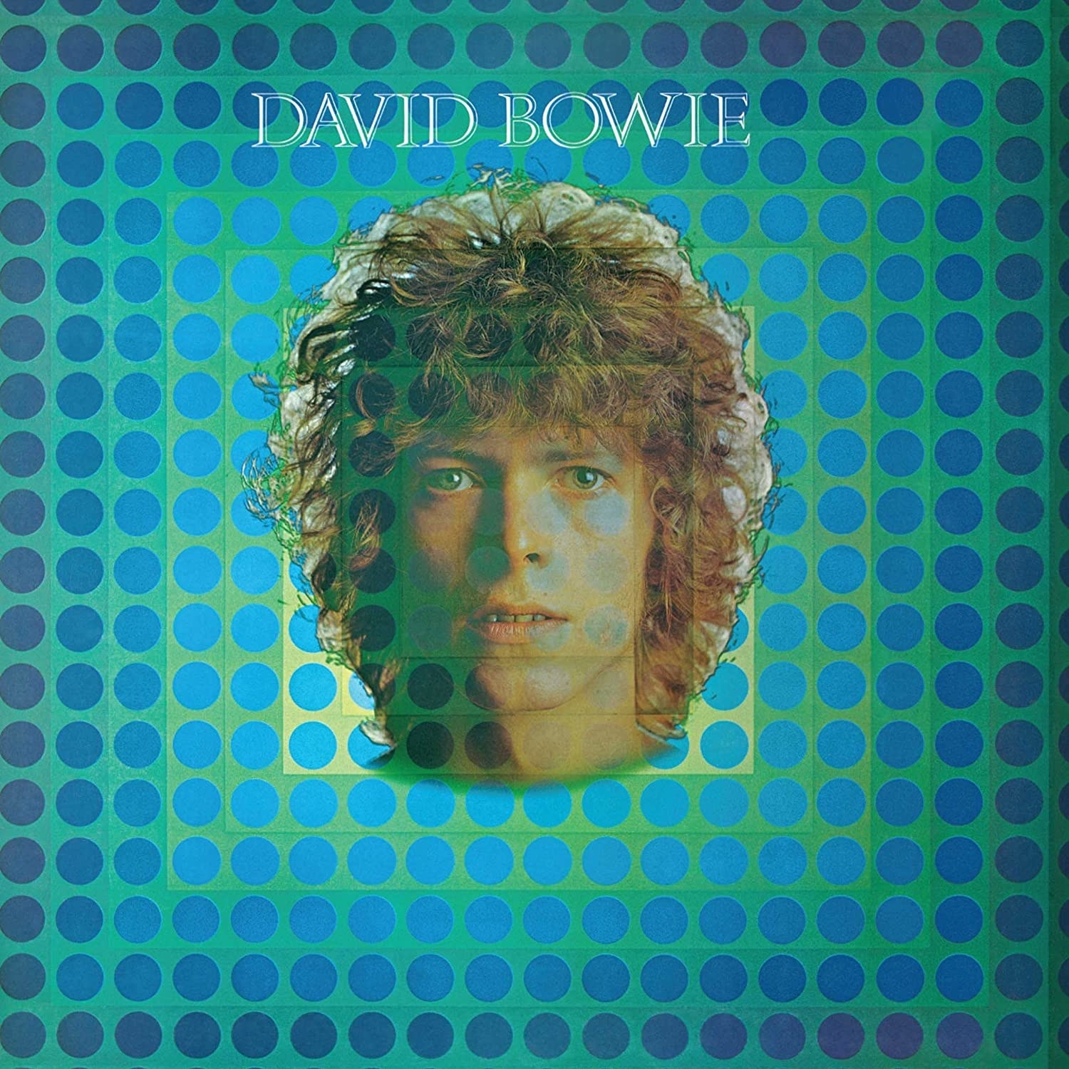 album cover of David Bowie showing a transparent image of Bowie's face
