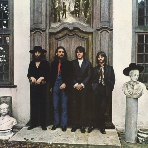album cover of Hey Jude showing the Beatles standing in front of the closed door