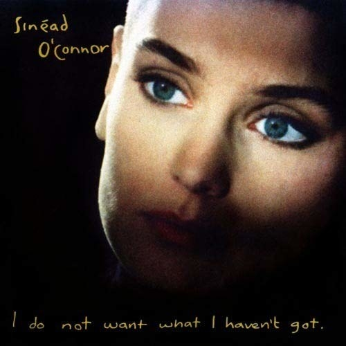 album cover of I Do Not Want What I Haven't Got showing Sinead O'Connor's face with only her eyes lit