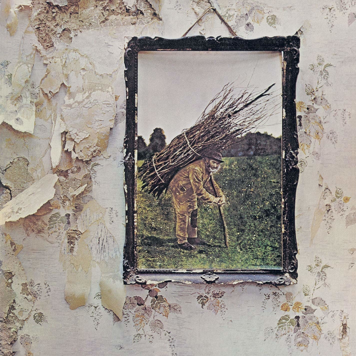 album cover of Led Zeppelin IV showing a framed image of an old man carrying a bundle of sticks on his back, hanging on a wall with worn and peeling wallpaper
