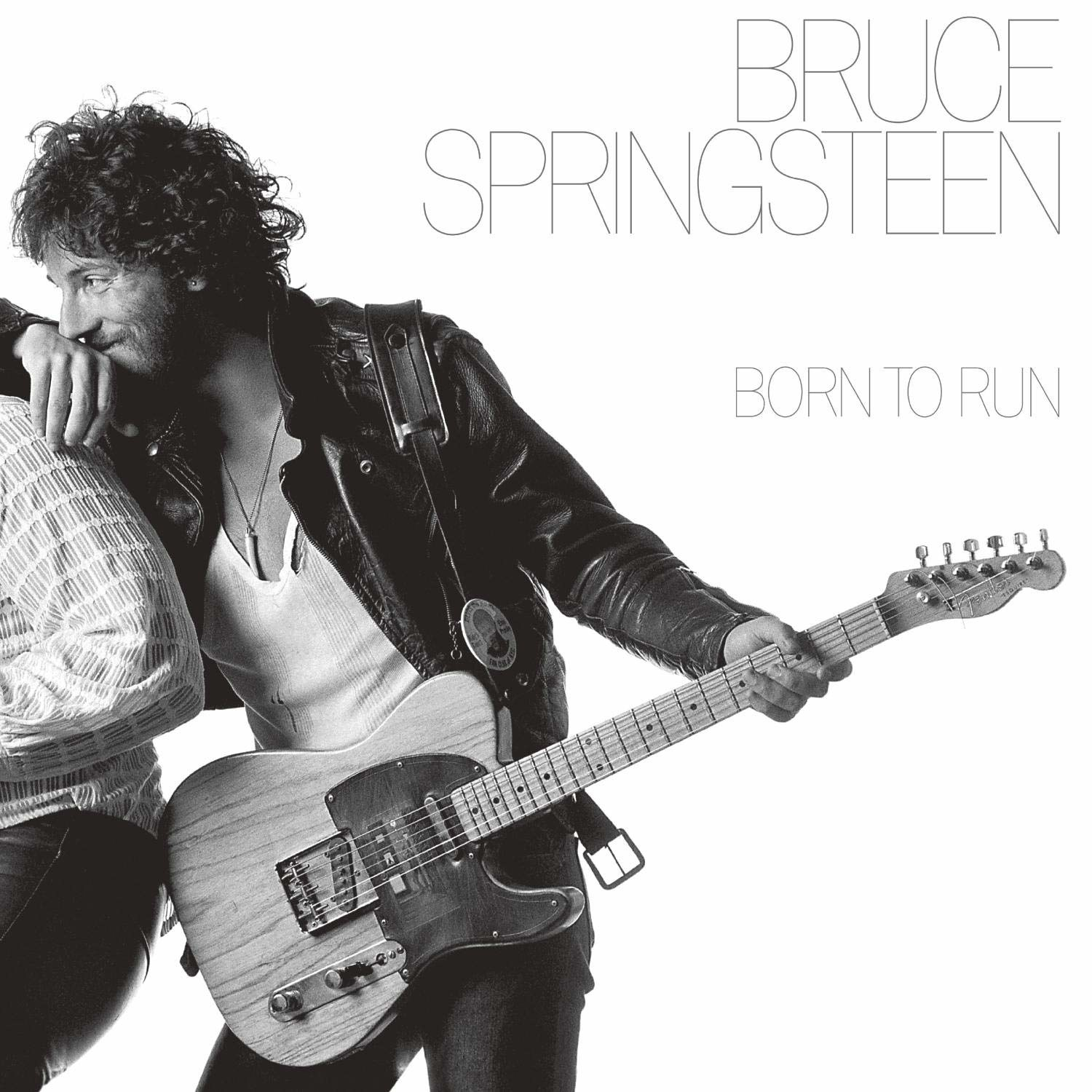 album cover of Born to Run showing Bruce Springsteen holding his guitar as he leans on someone else's shoulder