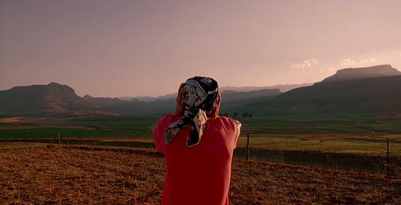 Leleti Khumalo as Yesterday overlooking a scenic vista in 'Yesterday'