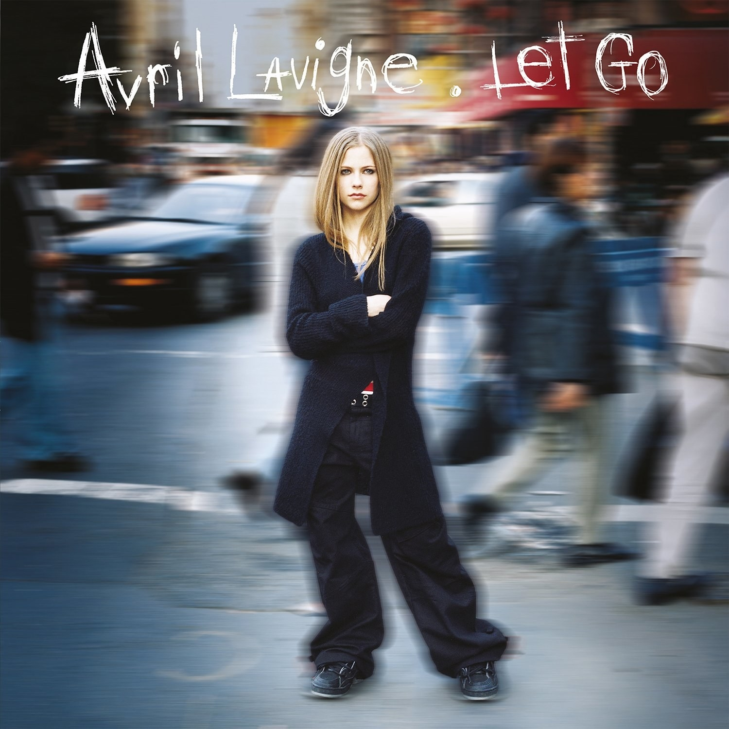 album cover of Let Go with Avril Lavigne standing in all black with her arms crossed as the blurred background depicts a busy street