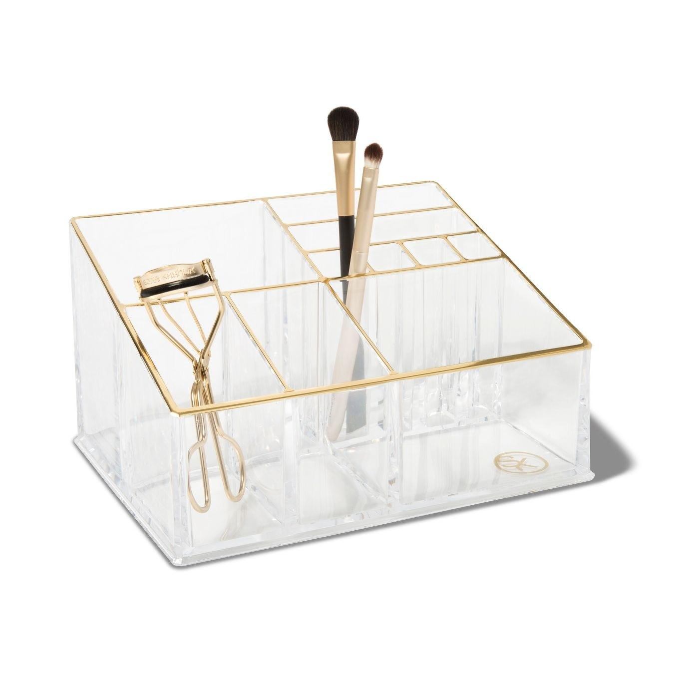 Clear plastic vanity organizer with gold accents