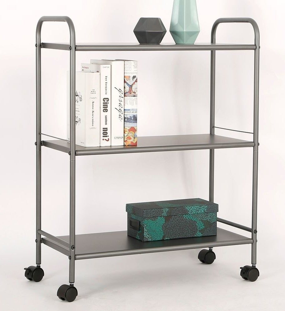 Sleek gray rolling cart with black wheels and three shelves