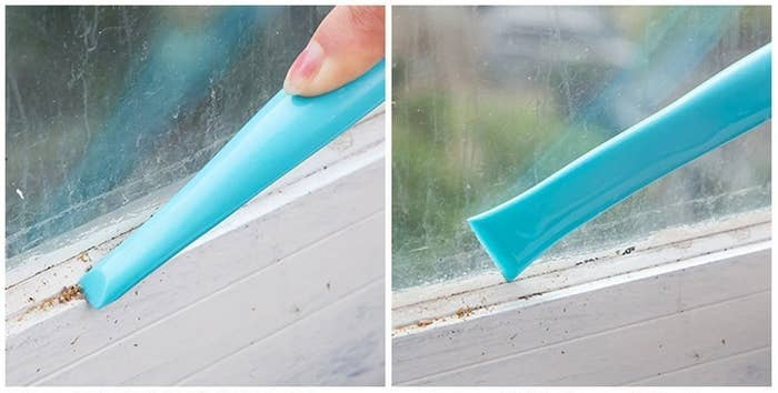 A person using both ends of the tool to clean dust out of a window frame