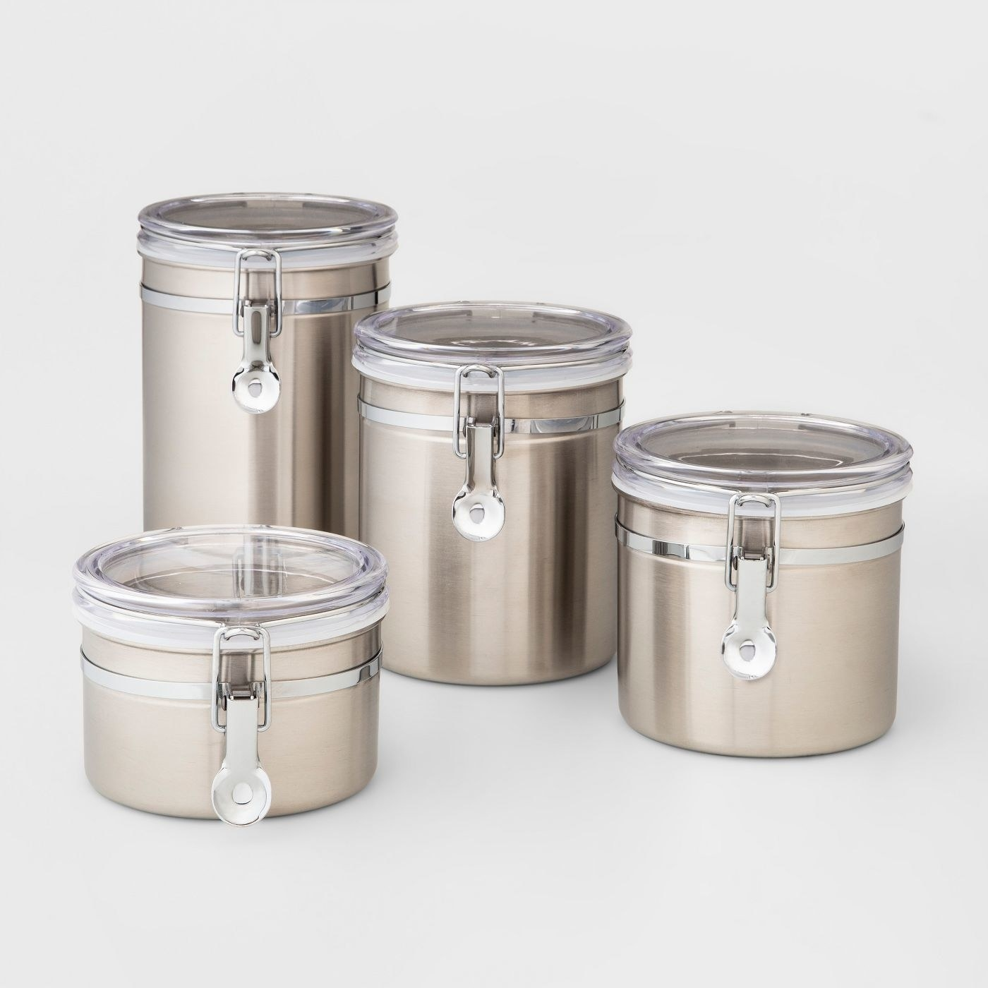 Set of four stainless steel canisters with plastic tops in various sizes