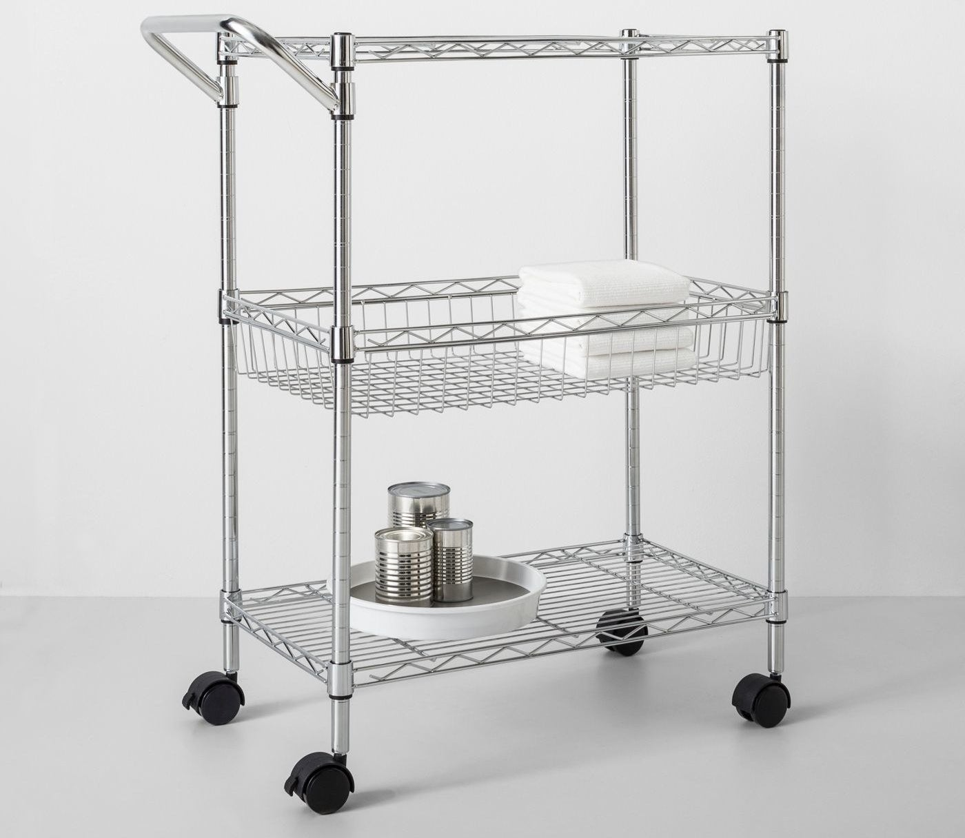 Stainless steel cart with handle and three shelves