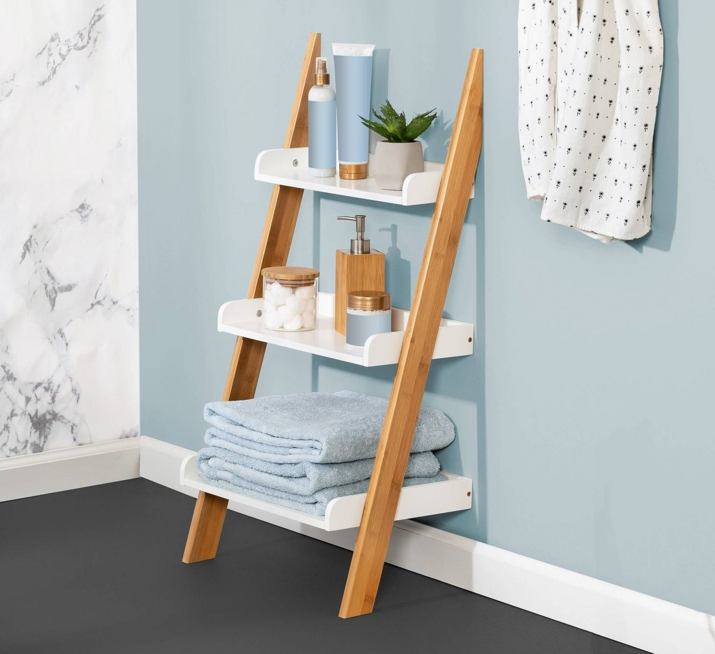 3-tiered leaning shelf with wood and white accents