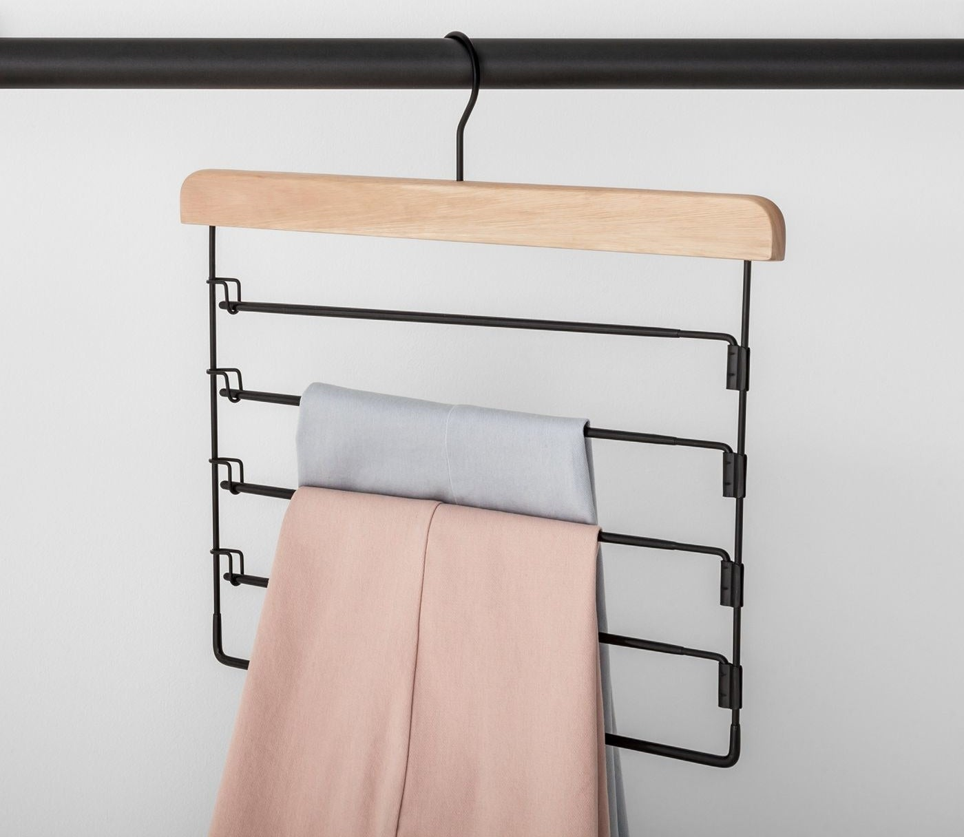 Wooden hanger with five metal areas for hanging pants