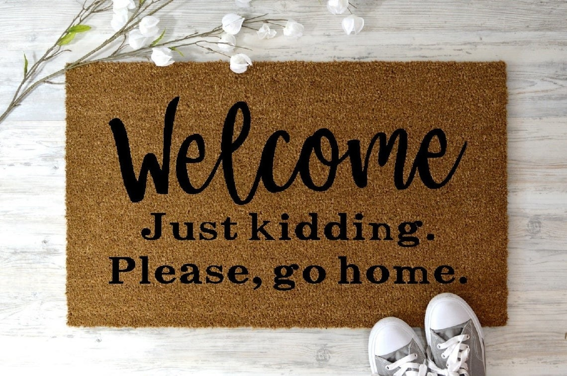 "Welcome mat that says ""Welcome Just kidding. Please, go home."""