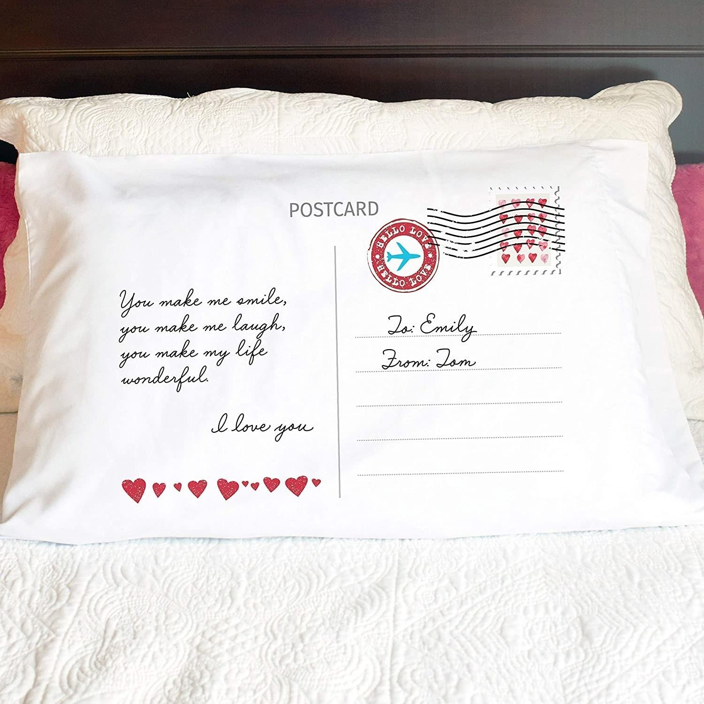 the white pillowcase with a postcard design