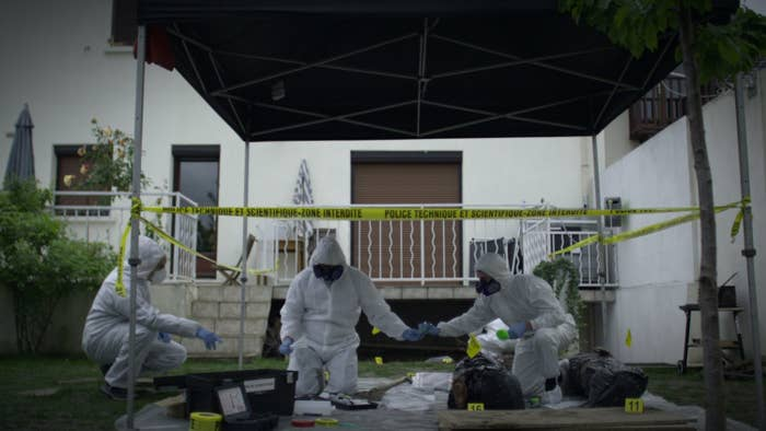 Investigators search the backyard of the Nantes home of a French count.