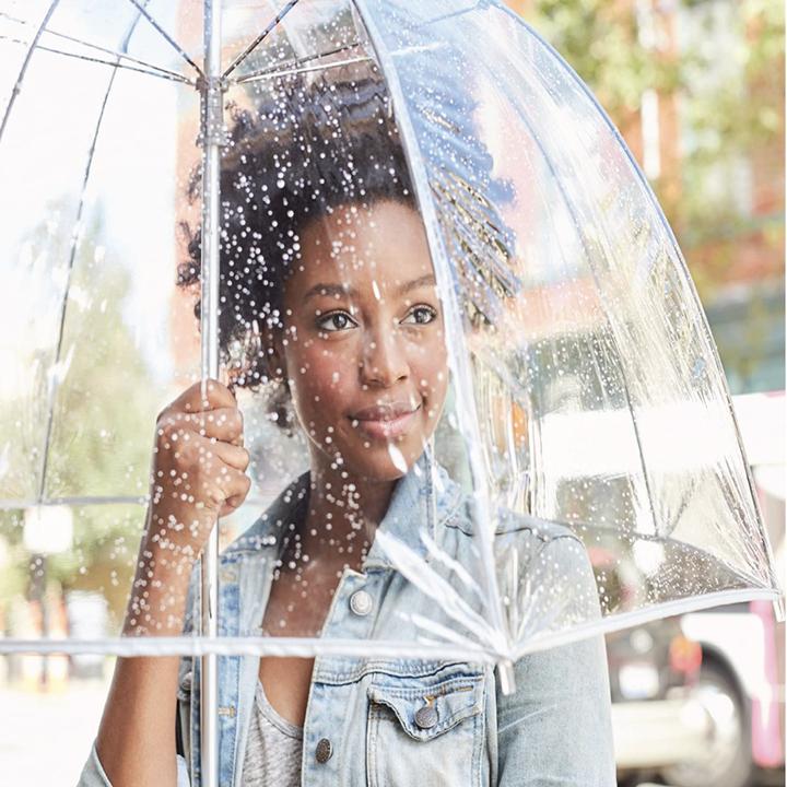 A model with a clear umbrella