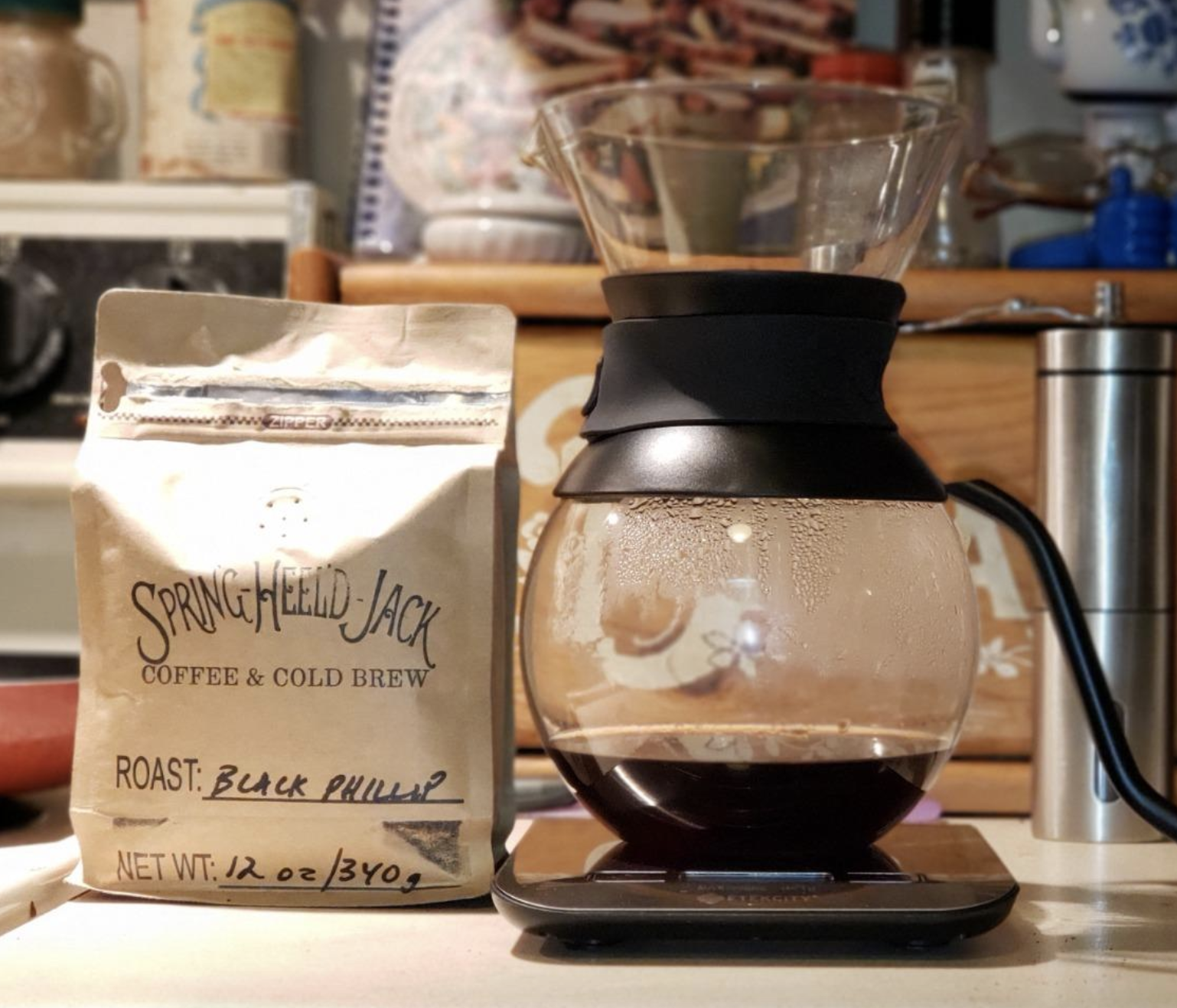 reviewer photo of clear coffee maker with coffee inside
