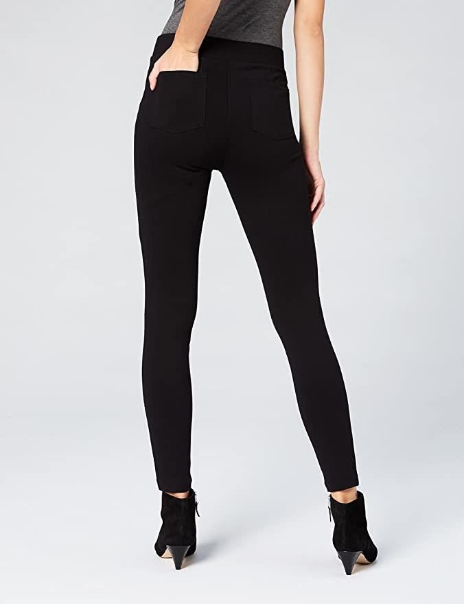 model wearing black leggings with back pocket