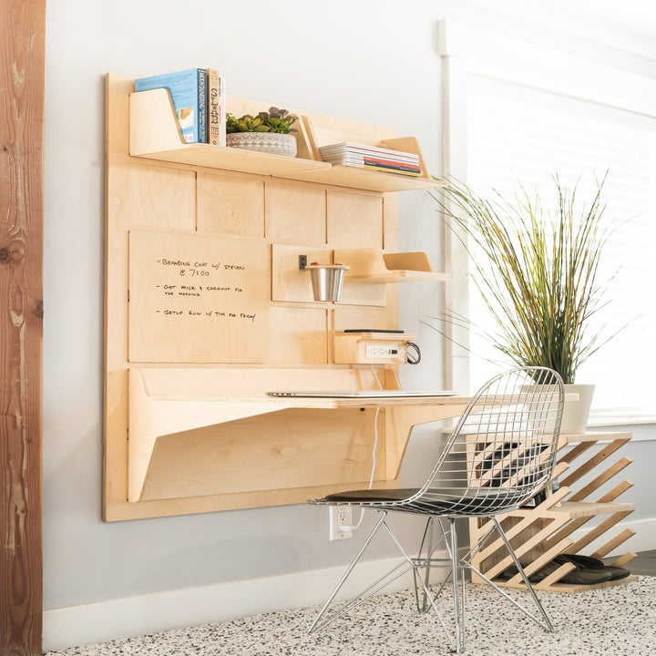 Wall mounted natural birchwood desk with tabletop, shelves, outlet charging station, and dry erase panel
