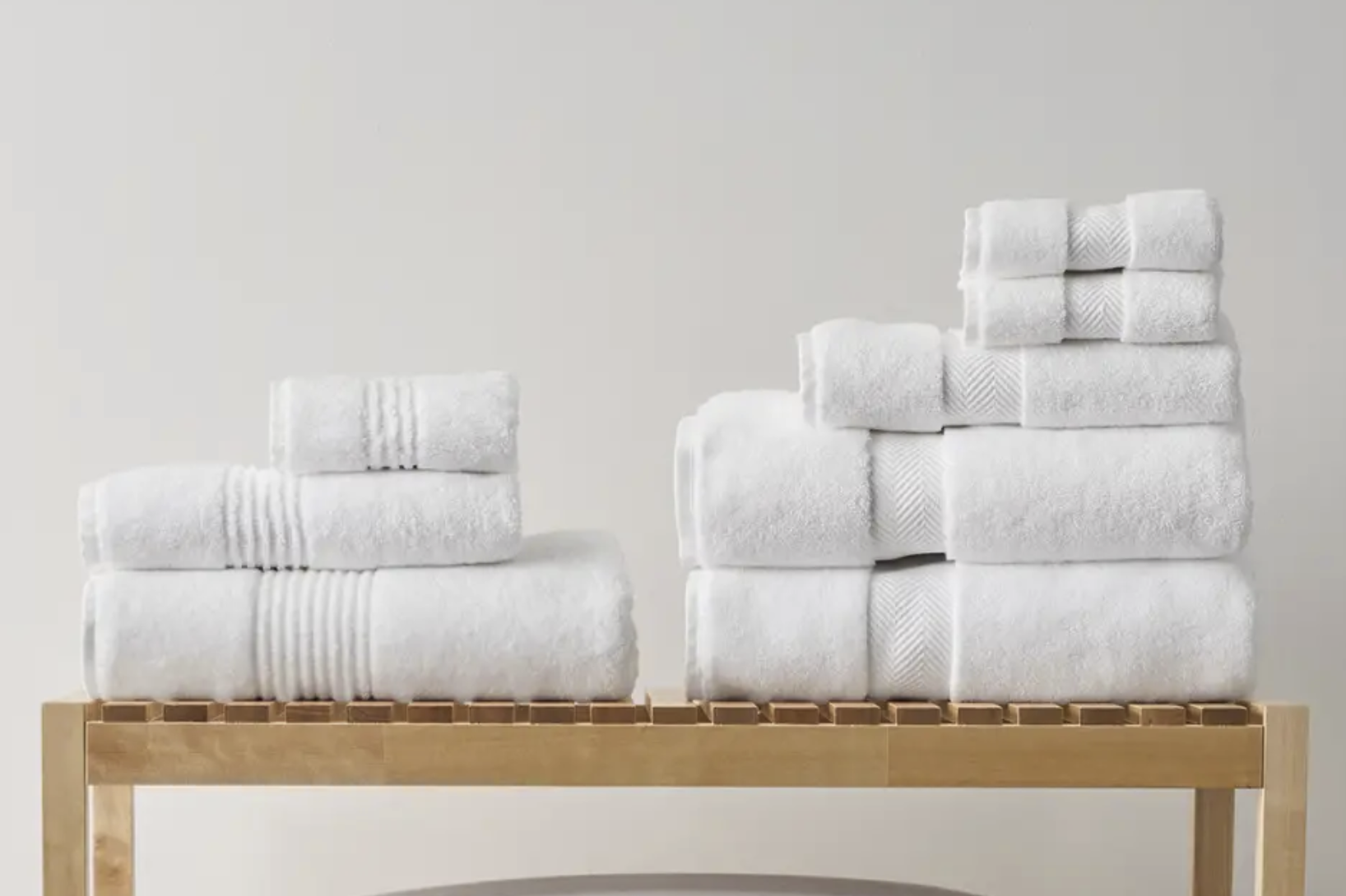 white towels folded on a wooden table