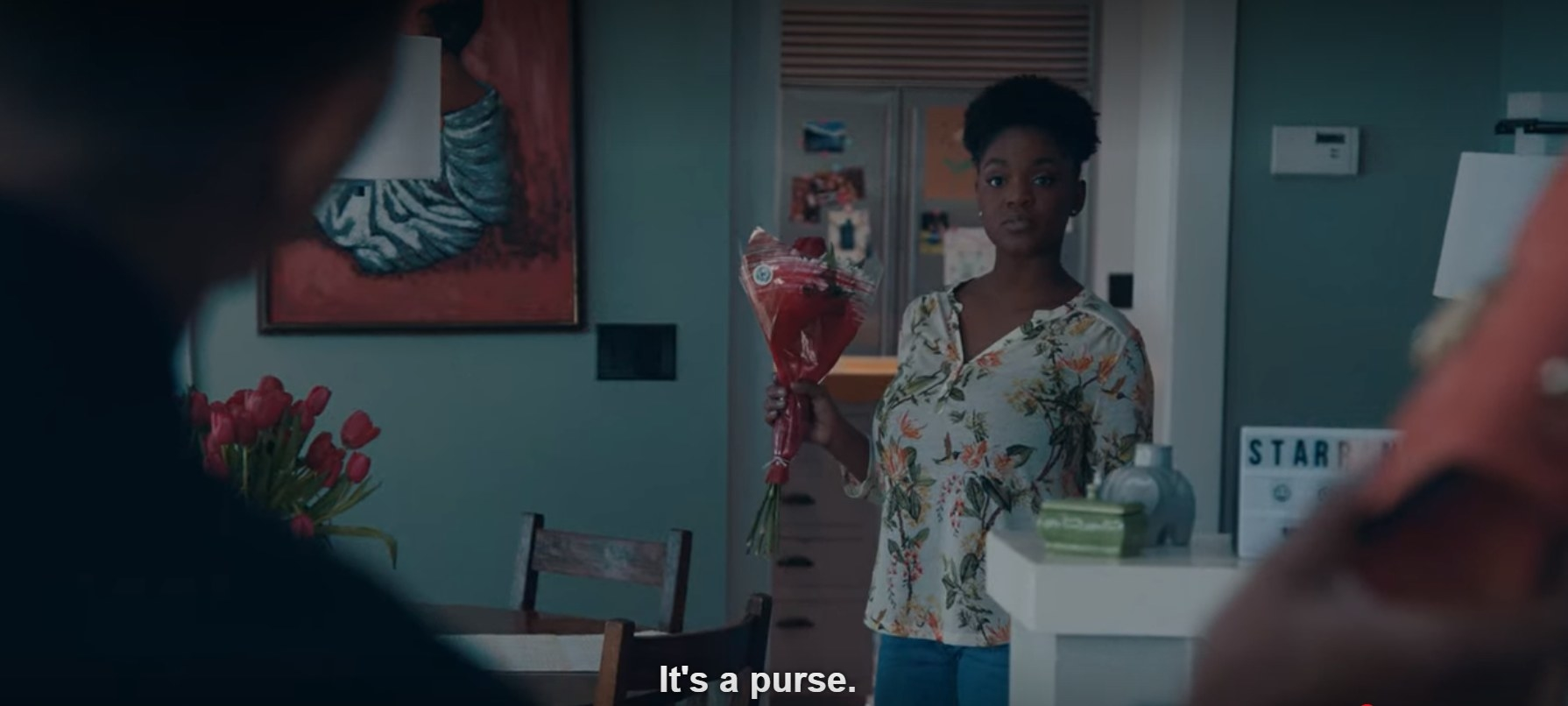 "A still image of Christine saying, ""It's a purse."""