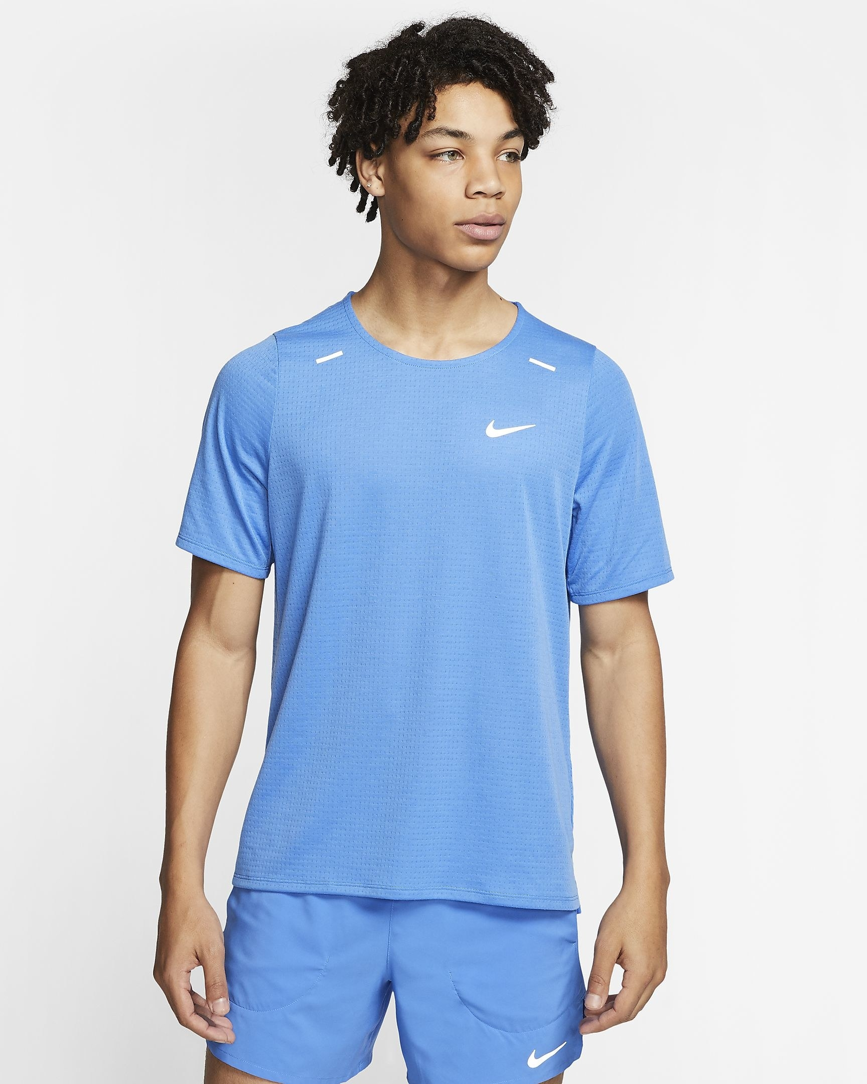 model wearing the blue shirt