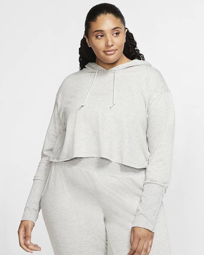 model wearing the gray hoodie