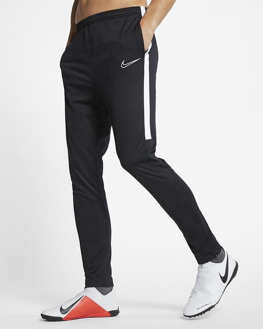 model wearing black joggers