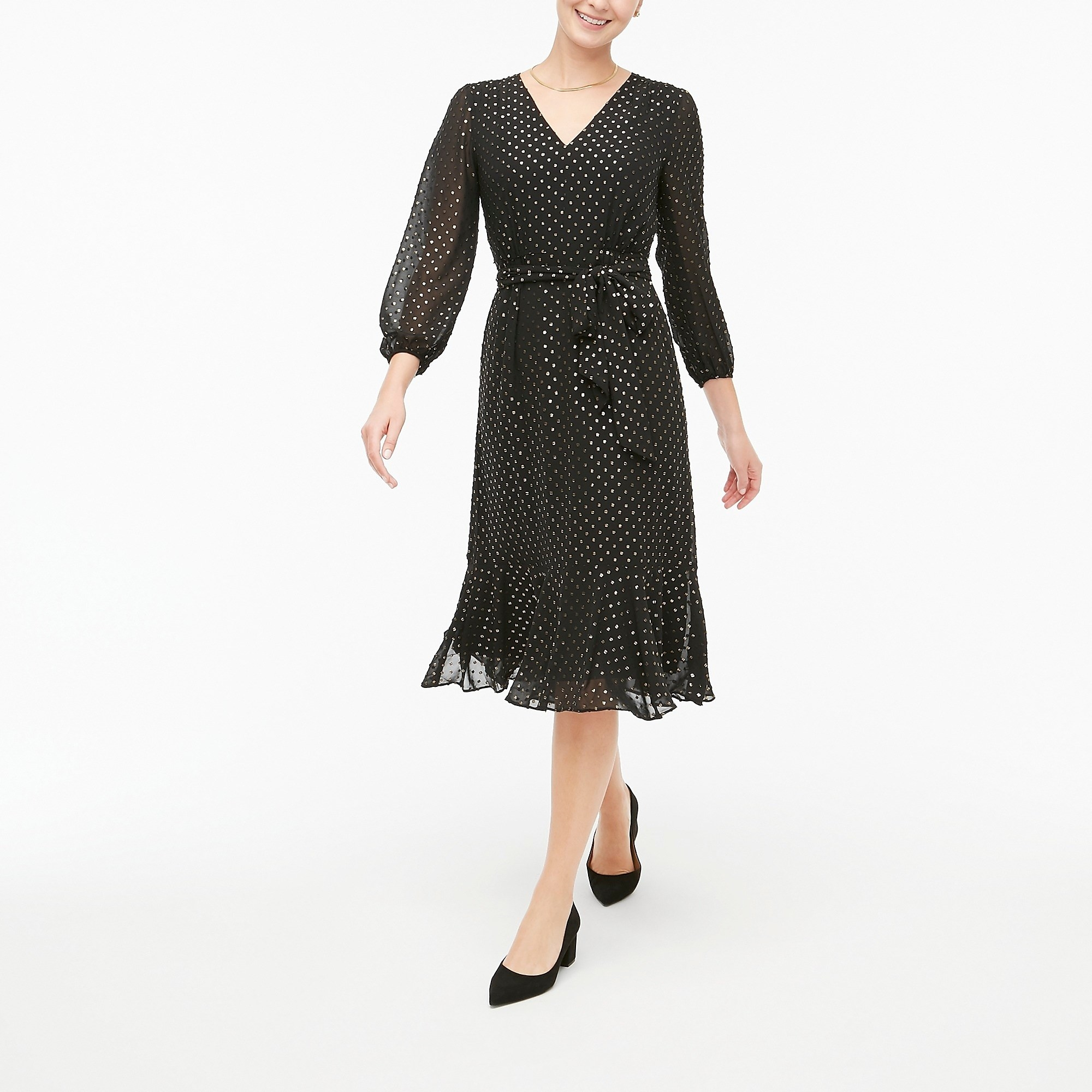 The black dress with shiny silver dots