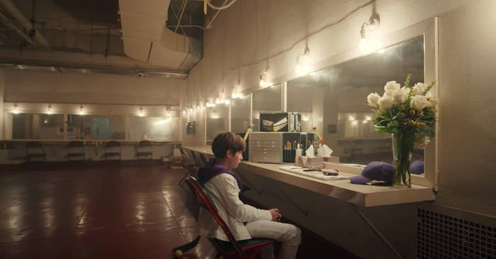 Young Justin sits alone backstage
