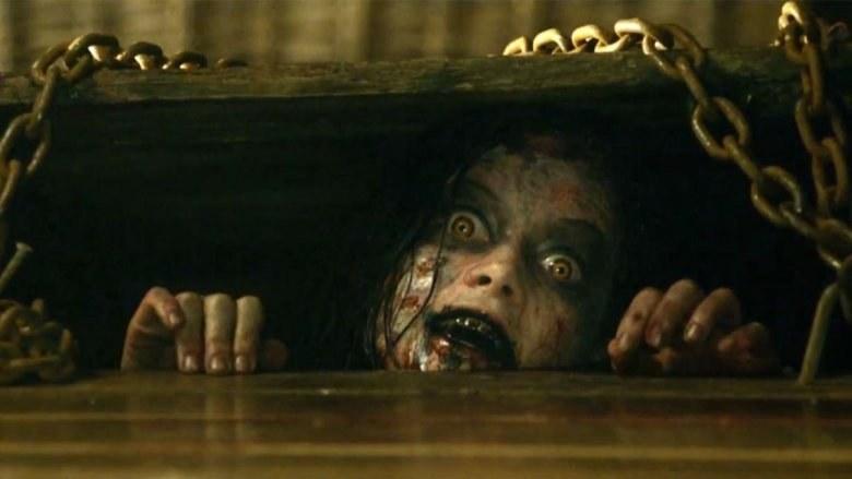 Scary woman in Evil Dead basement