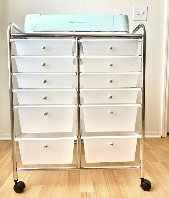 the storage cart with two columns of six drawers a piece that get larger as you cascade down
