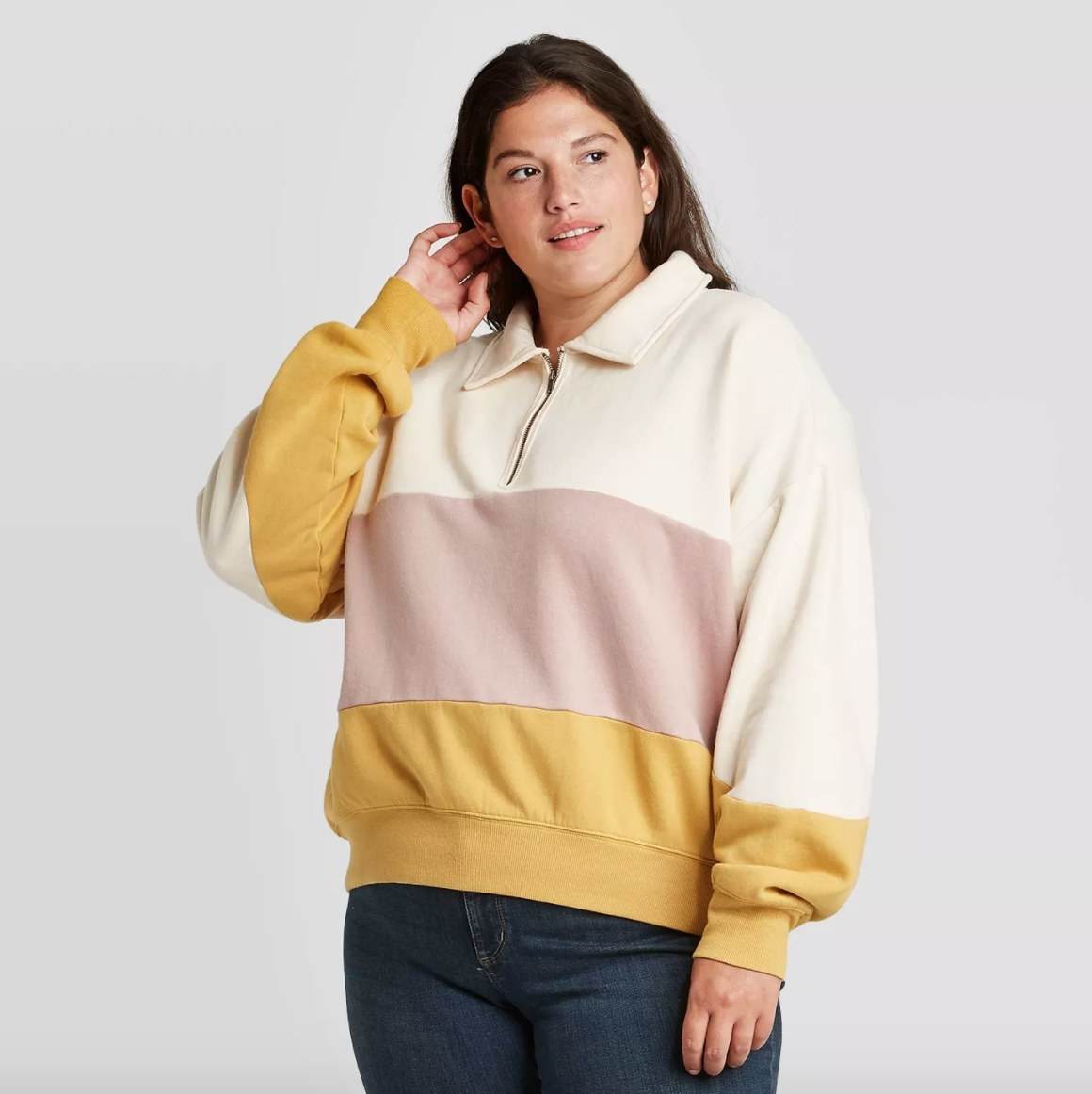 The sweatshirt in the color yellow/cream