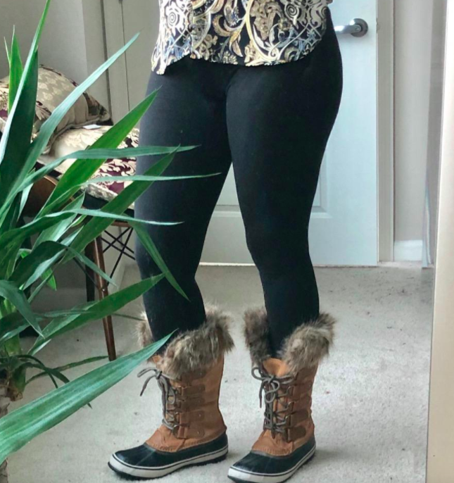 reviewer wearing the fleece-lined leggings with winter boots