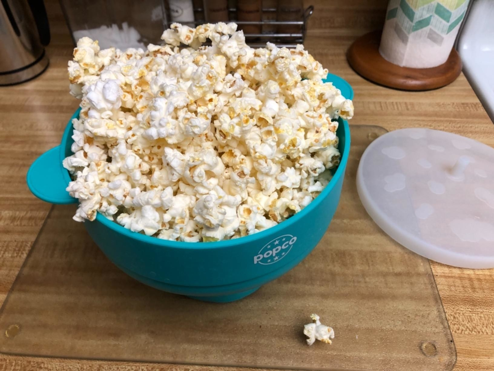 A reviewer's photo of the blue popper, filled with popcorn