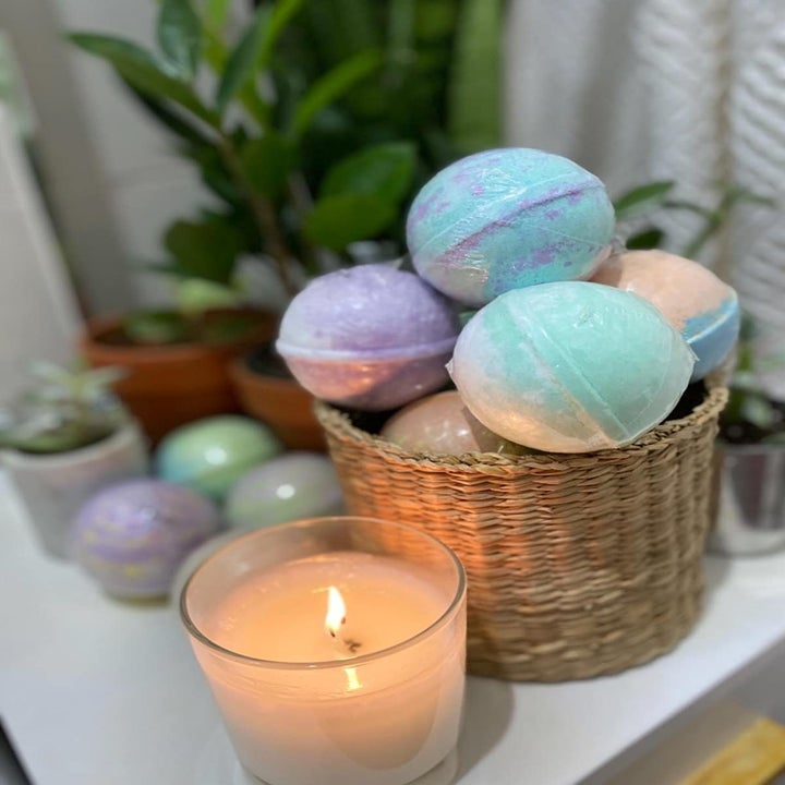 A reviewer's basket with the colorful bath bombs inside