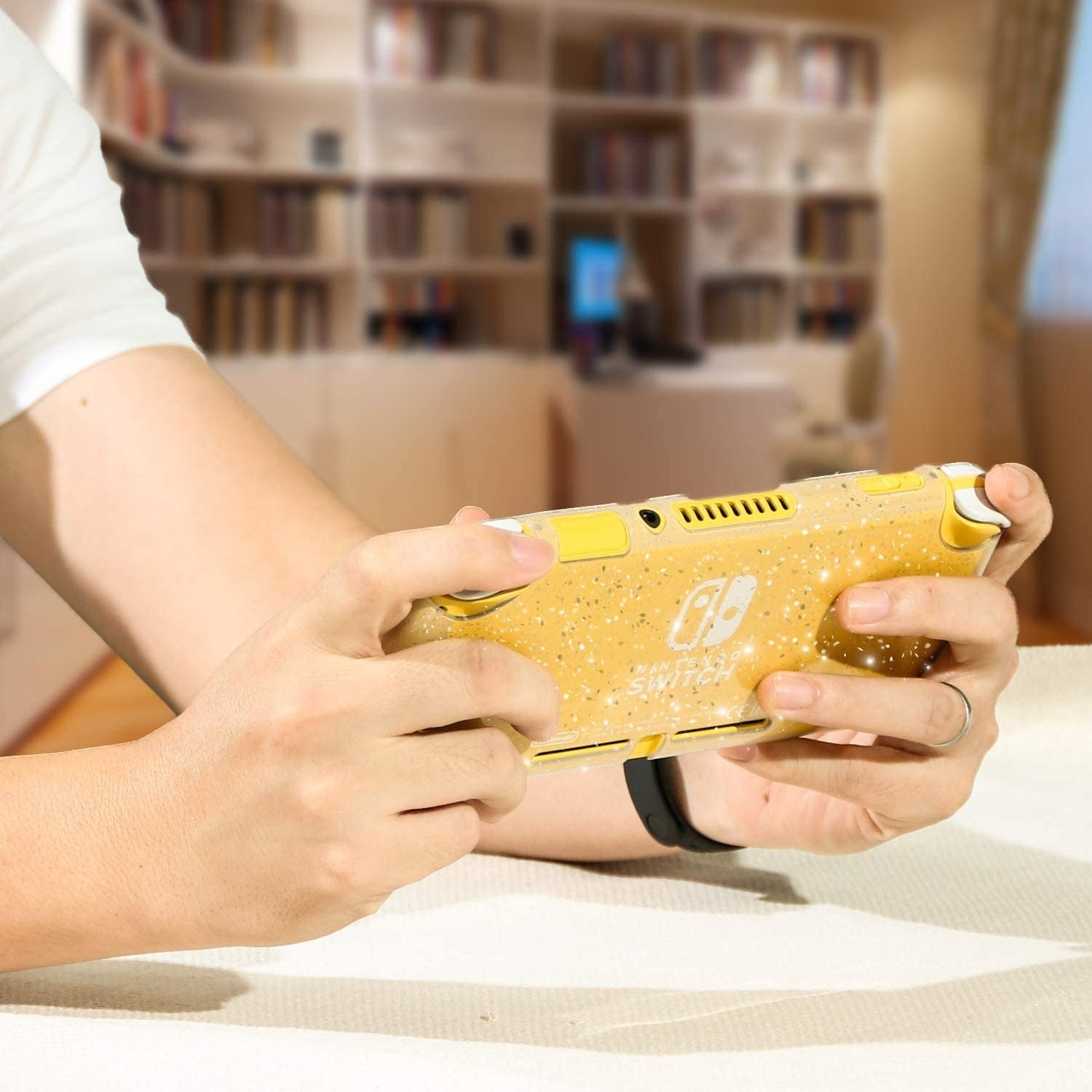 A person holding their Switch Lite with the protective case on it